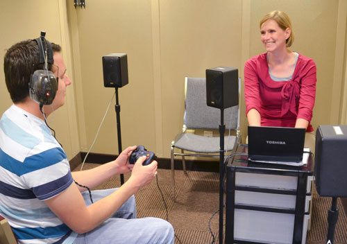 Student researcher, Karen Story, and research participant conducting research with the KUDUwave Audiometer